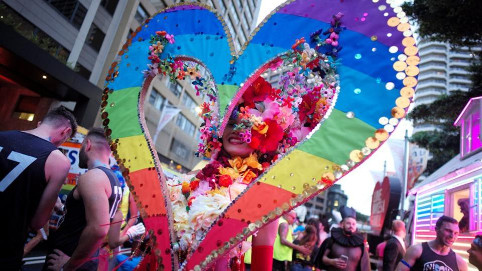 A participant in the annual Sydney Gay and Lesbian Mardi Gras festival wears a rainbow coloured heart outfit. The defence forces, police and firefighters all sent contingents to march in uniform, and the surf lifesavers were a crowd favourite in their swimming trunks. (Jason Reed/REUTERS)