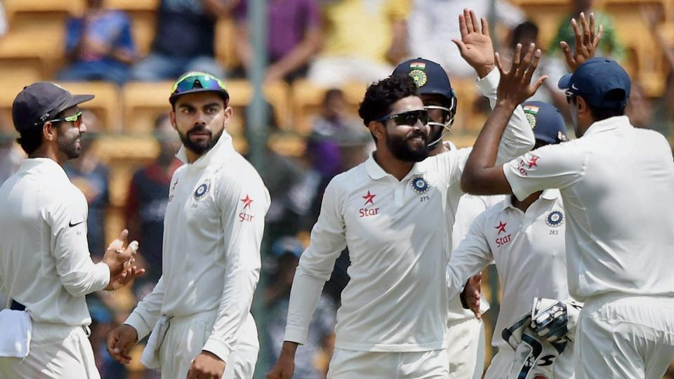 India's Ravindra Jadeja with team mates celebrate the wicket of Australia's Steve Smith during the second day of Bangalore Test.