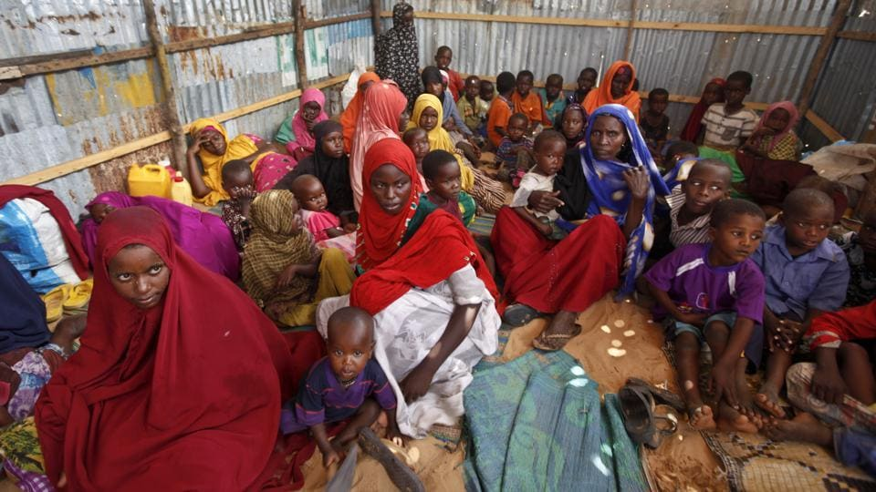 Displaced Somalis who fled the drought in southern Somalia sit in a camp in the capital Mogadishu in Somalia.
