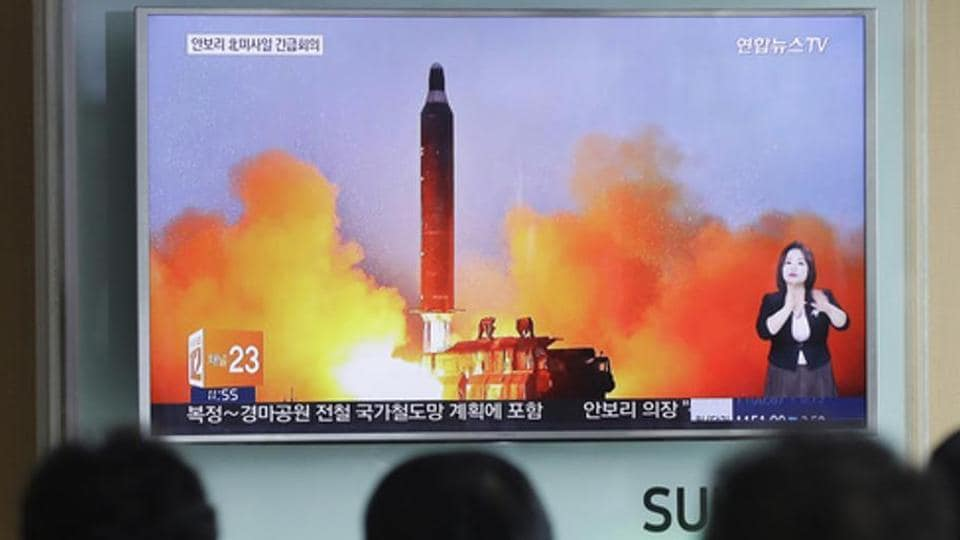 People watch a TV news channel airing an image of North Korea's ballistic missile launch published in North Korea's Rodong Sinmun newspaper at the Seoul Railway Station in Seoul, South Korea.