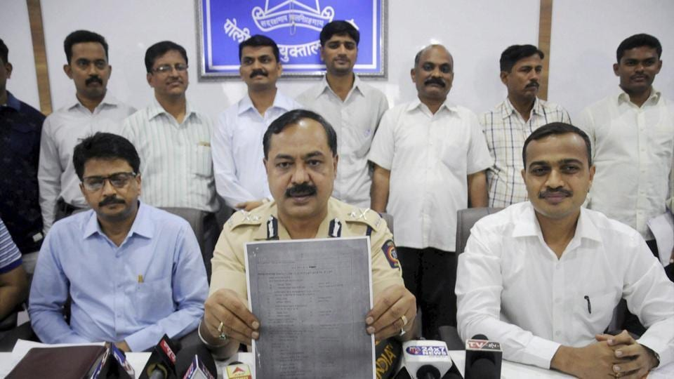 Thane Crime Branch officials show an examination paper of the Army Recruitment Board that was allegedly leaked, in Mumbai on Sunday.