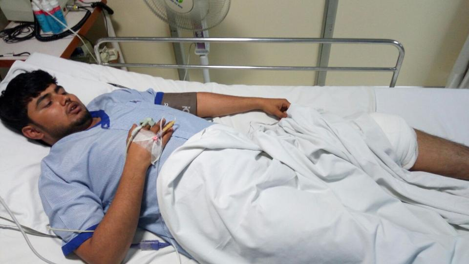 24-year-old Abhishek Mishra recuperating at Kailash Hospital in Noida on Monday. He was shot on his left leg.