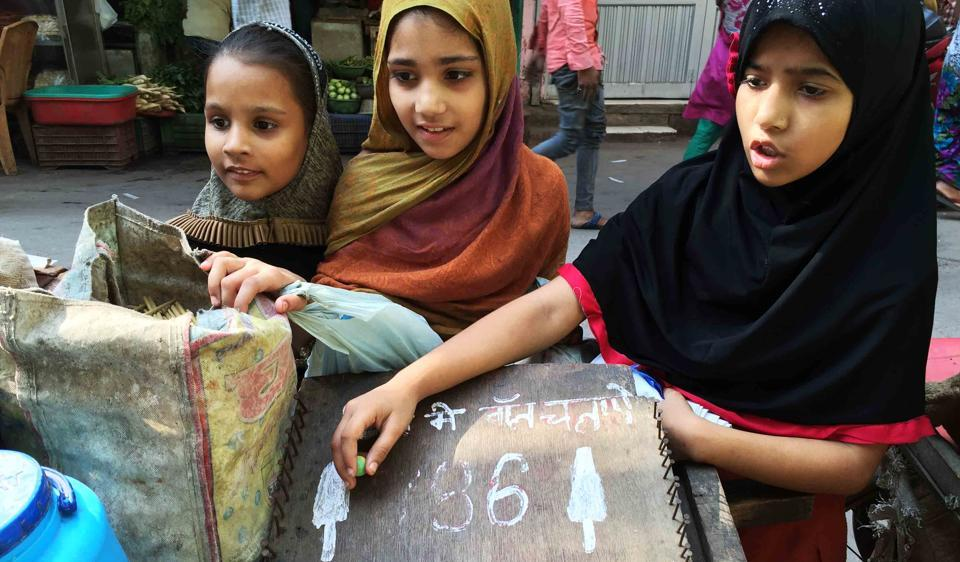 Girls line up for the numberwalli kulfi near Turkman Gate in Old Delhi. It's one element of Delhi summer that is fast receding into memories.