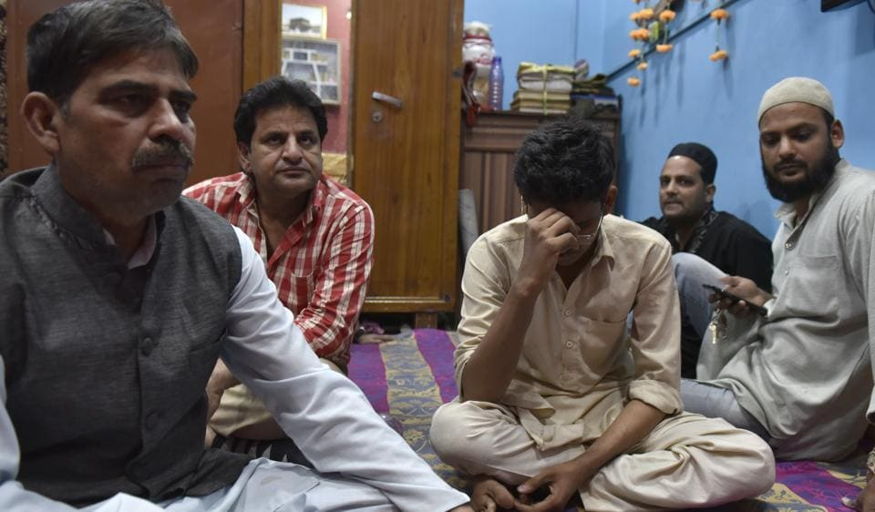 The family of Ayyub Sheikh, a first year BA student who got electrocuted atop a train at Nizamuddin on Monday.