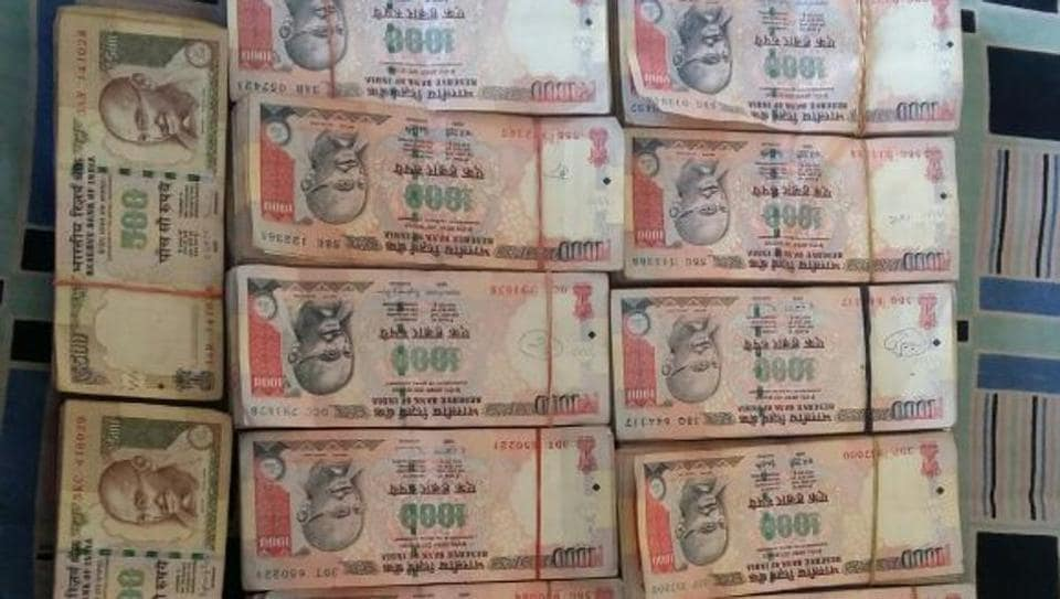 All 248 notes seized on Sunday are in denominations of ₹500 and ₹1,000 that are not legal tender anymore.