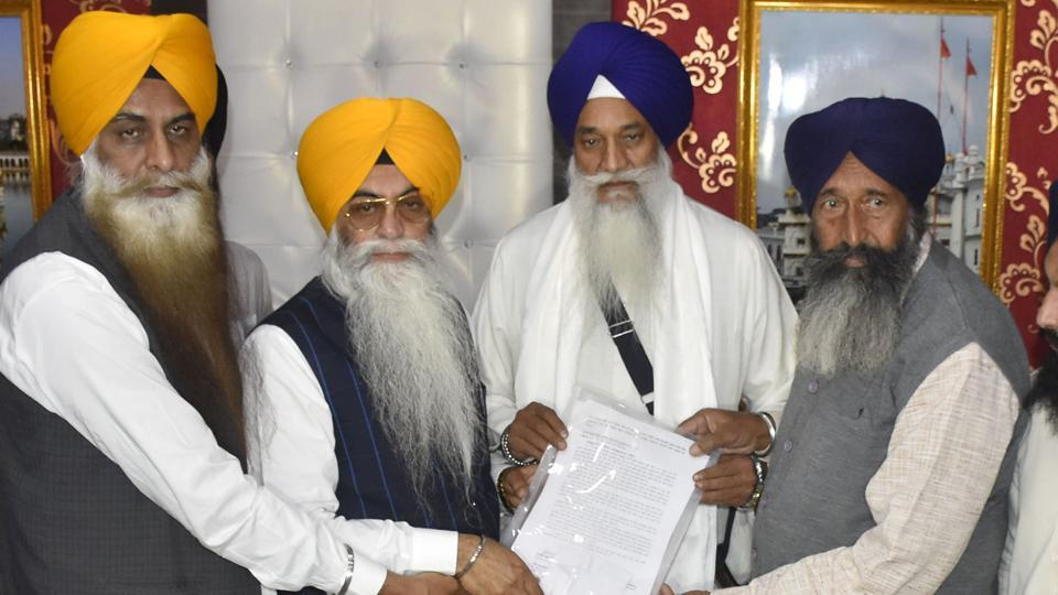 SGPC probe panel submitting its report to Akal Takht jathedar Giani Gurbachan Singh (second from right) in Amritsar on Monday.