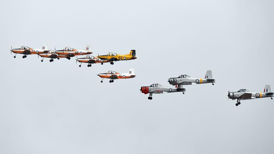 A flying display comprised of PAC CT-4 (L) and vintage CA-25 Winjeel (R) trainer aircraft from the Royal Australian Air Force Museum fly in formation during the Australian International Airshow in Melbourne. (MAL FAIRCLOUGH  / AFP)