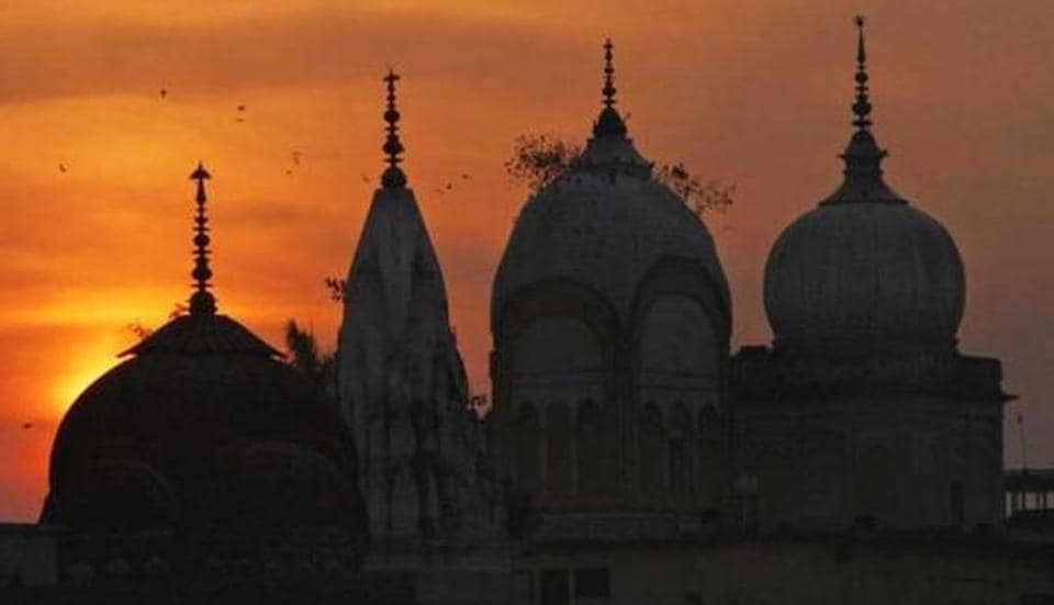 Birds fly at sunset over a Hindu temple in Ayodhya. AP File Photo