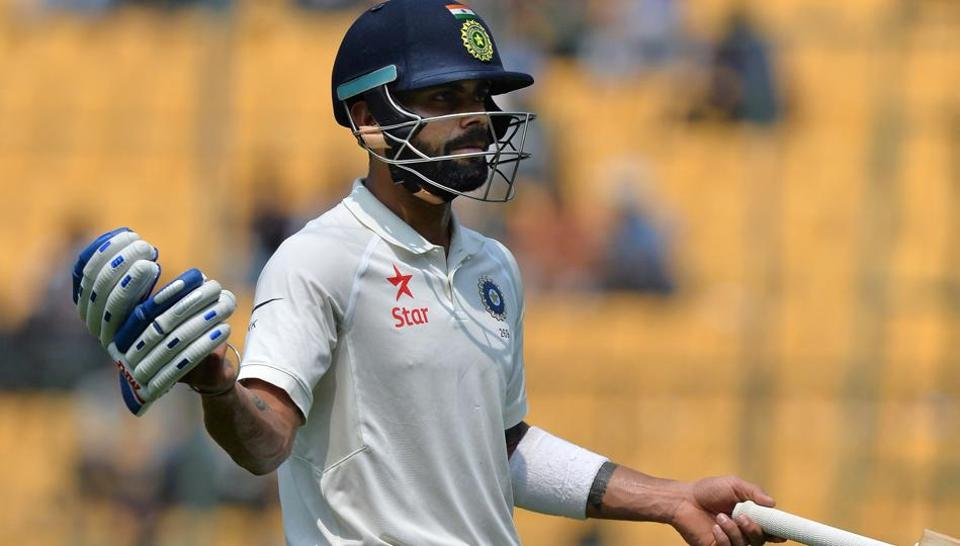 Indian cricket team skipper Virat Kohli reacts as he walks back to the pavilion after losing his wicket against Australia in Bangalore.