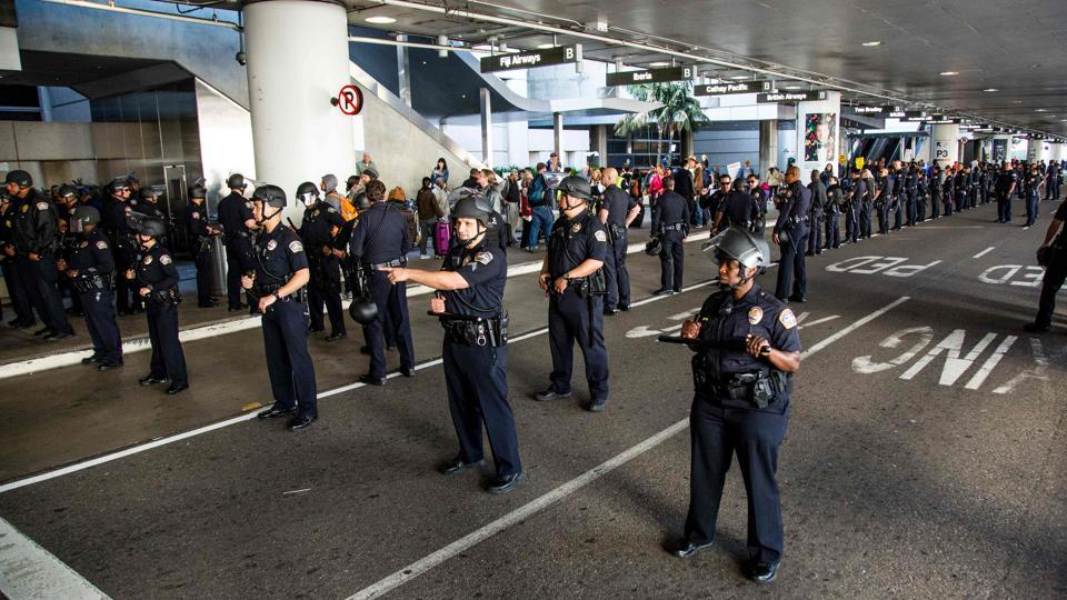 Los Angeles Airport police guard a protest against the executive order by US President Donald Trump, banning immigrants from seven majority-Muslim countries at Los Angeles International Airport in Los Angeles, California, February 4.