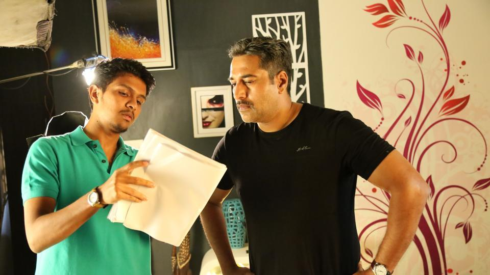Director Karthick Naren interacts with actor Rahman on the sets of 2016's Dhuruvangal 16.