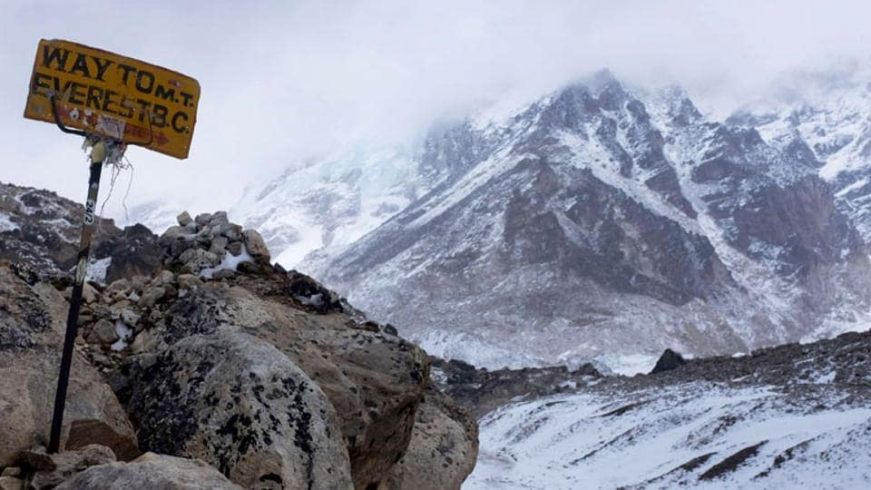 A sign shows the way to Everest Base Camp high in the Khumbu Glacier.