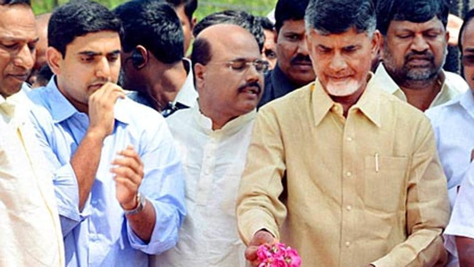 Andhra Pradesh chief minister N Chandrababu Naidu (second from right) with his son Nara Lokesh (left; in blue) pay floral tributes to TDP founder and former chief minister NT Rama Rao.