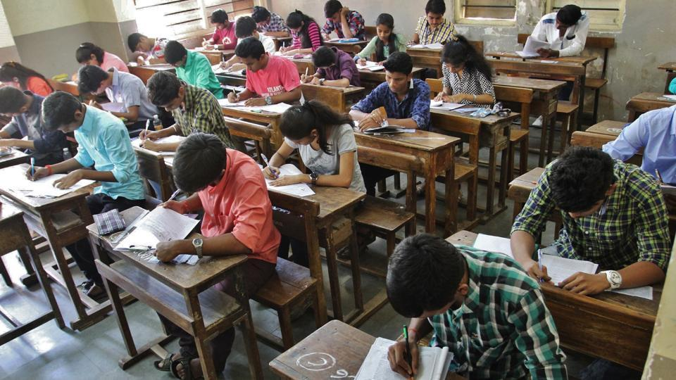 Students take the Higher Secondary Certificate (HSC) exams in Thane.