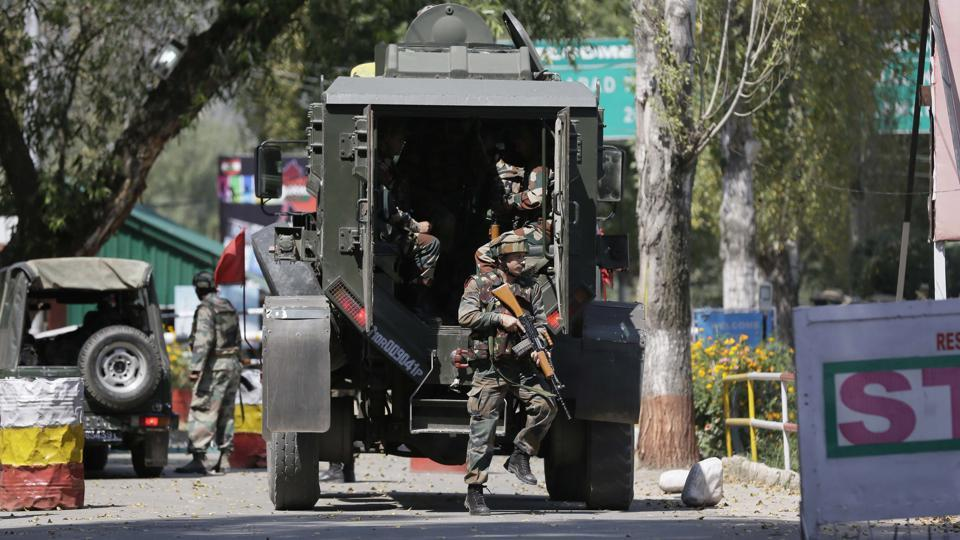 Army soldiers arrive at the army base which was attacked by militants in the town of Uri, Srinagar.