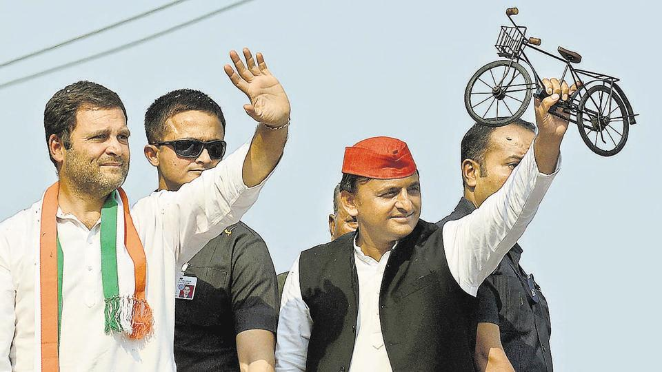 Uttar Pradesh Chief Minister and Samajwadi Party leader Akhilesh Yadav (R) and Congress vice­ president Rahul Gandhi (L) waving to the crowd during a joint roadshow in Varanasi.