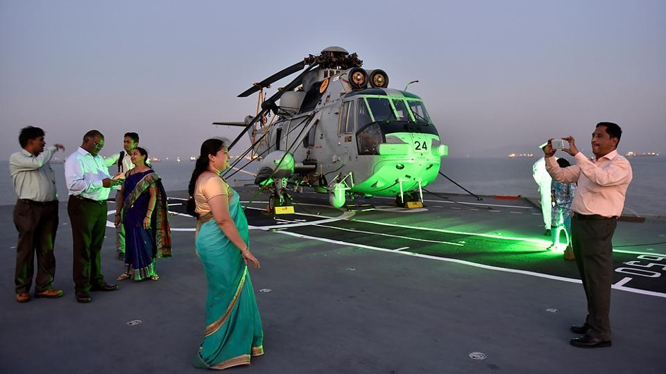 People take photos on board Viraat one last time. (Anshuman Poyrekar/HT Photo)