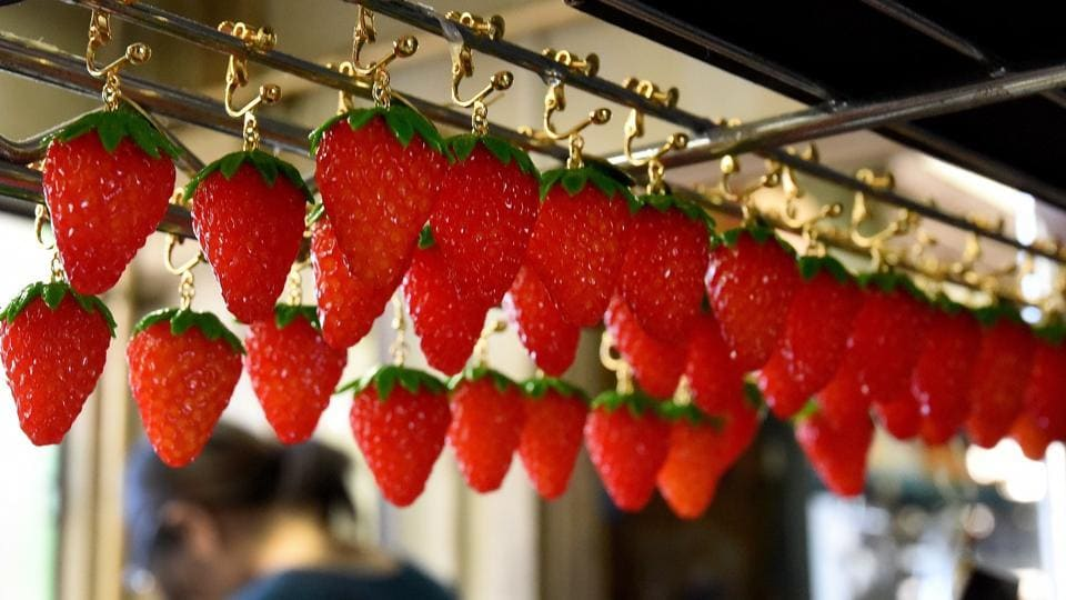 Plastic strawberry earrings made at the studio of Fake Food Hatanaka in Tokorozawa, a suburb of Tokyo. (TORU YAMANAKA  / AFP)
