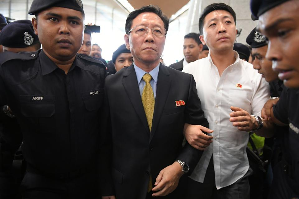 Expelled North Korean ambassador to Malaysia Kang Chol (centre) is escorted by police to the departure hall of the Kuala Lumpur International Airport in Sepang on Monday.
