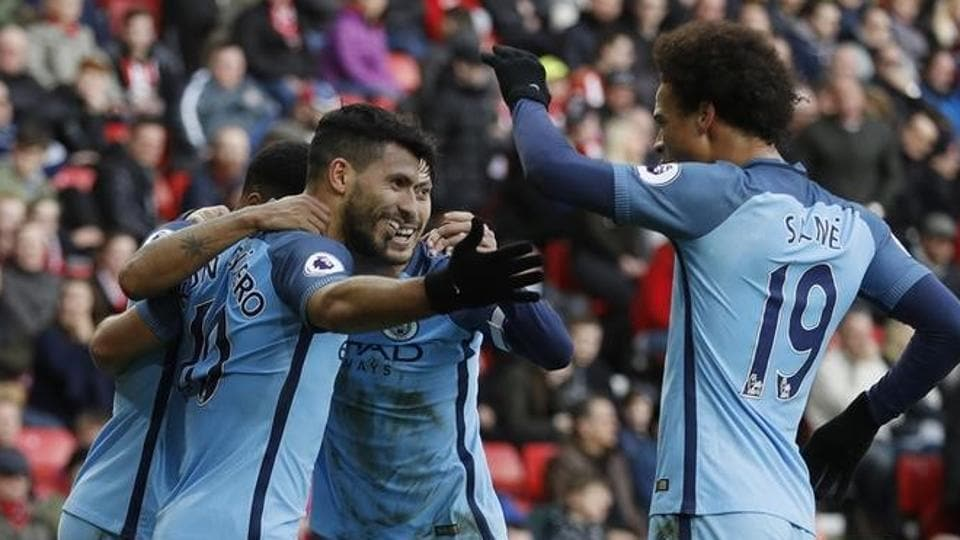 Manchester City FC's Sergio Aguero celebrates with teammates after scoring their first goal against Sunderland in the Premier League on Sunday.