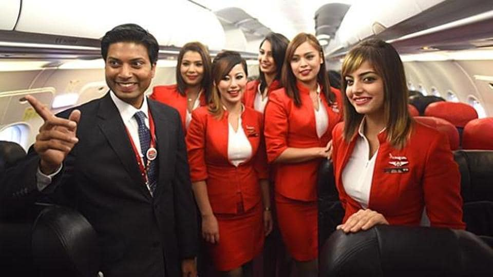Air Asia's former CEO Mittu Chandilya with crew members after a test flight from the New Delhi airport.