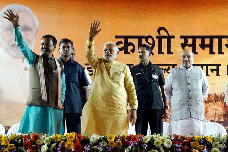Varanasi:Prime Minister Narendra Modi with BJP President Amit Shah waves at crowd during an election campaign rally in support BJP candidates in Varanasi on Sunday. PTI Photo(PTI3_5_2017_000249A)
