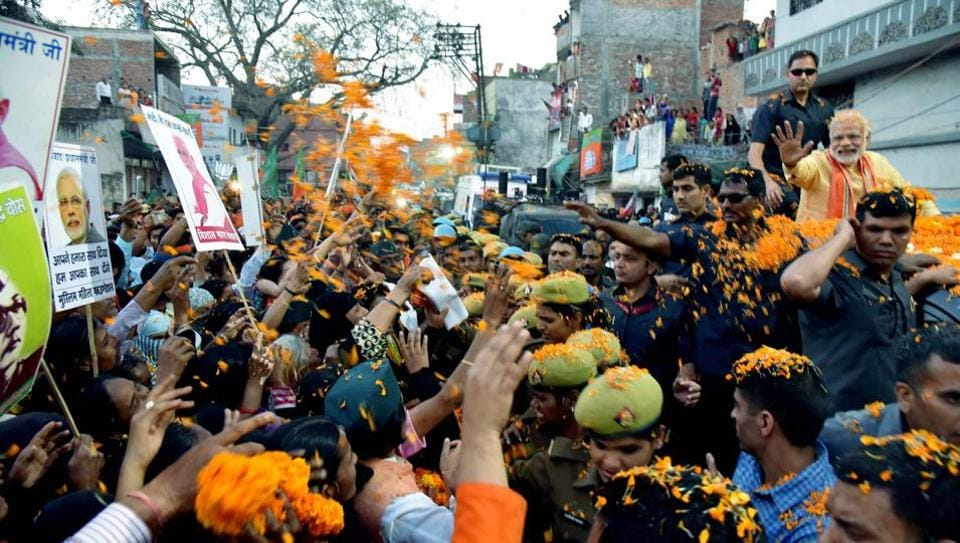 Supporters gather to see Prime Minister Narendra Modi during his road show in Varanasi on Sunday.