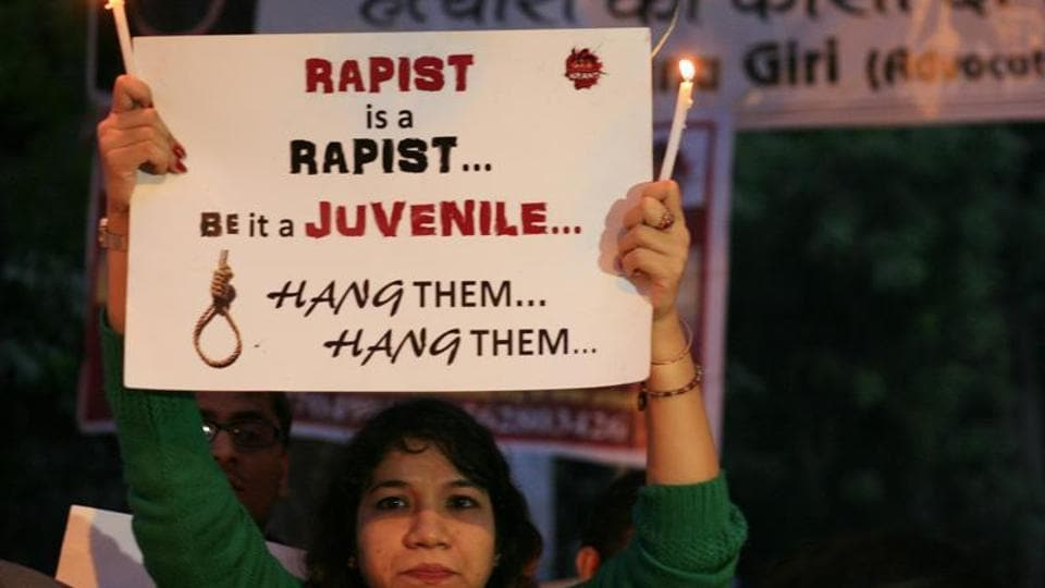 A student activist shows a placard during a protest against the December 16 gang rape in New Delhi.