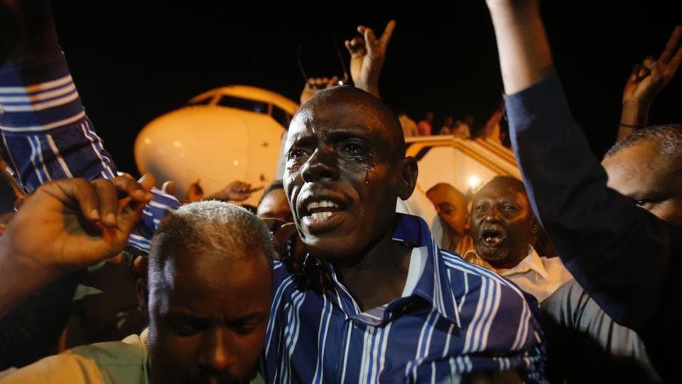 A freed Sudanese prisoner, who had been captured by the rebel Sudan People's Liberation Movement-North (SPLM-N), reacts upon his arrival at Khartoum airport on March 5.