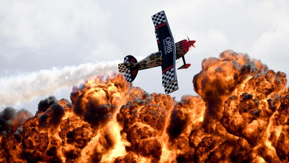 A member of the Tinstix of Dynamite aerobatics team flies in front of a wall of fire during the Australian International Airshow in Melbourne. (MAL FAIRCLOUGH / AFP)