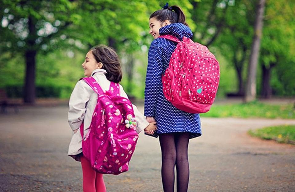 New research suggests that carrying a backpack to school has a more detrimental effect on children's health than pulling a trolley.