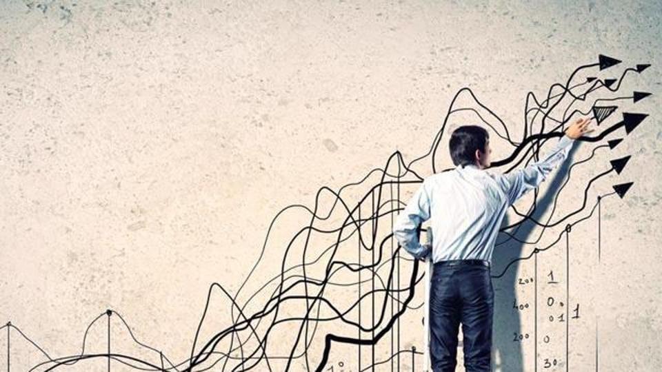A man drawing a graph