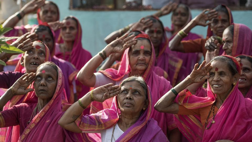 Dressed in bright pink saris, the grannies all sit together in a single classroom and learn to write, read and multiply, all in Marathi. On International Women's Day 2017, the women will mark their one-year anniversary with celebrations. (Satish Bate/HT PHOTO)