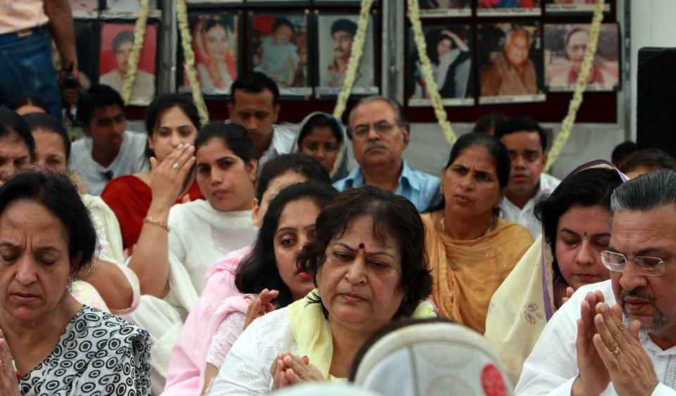Relatives of Uphaar tragedy victims pay tribute to the departed souls, at the memorial set up near the cinema hall.