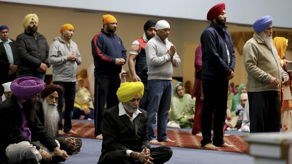 People attend services at Gurudwara Singh Sabha in Renton, Washington in south of Seattle. A Sikh man was shot by a gunman in his arm and told him