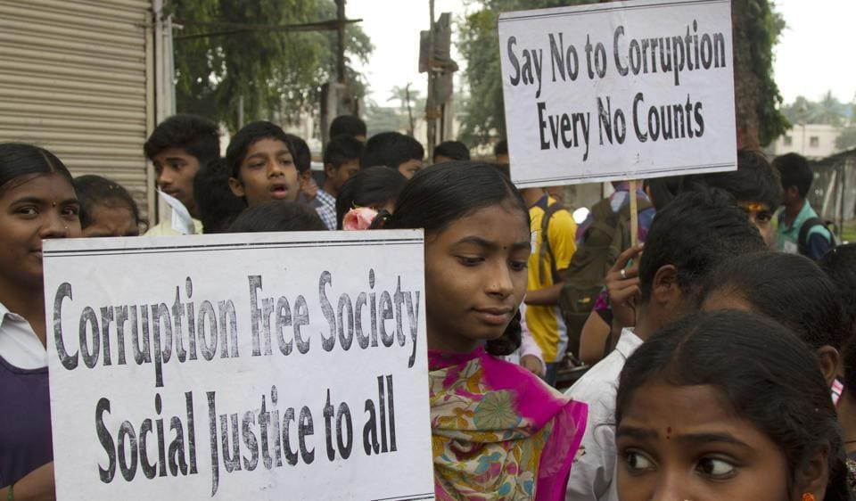 A file photo, Indian school students participate in a protest against corruption in Hyderabad, India. A survey anti-graft rights group Transparency International, found 69% in India as saying they had to pay a bribe to get public services.