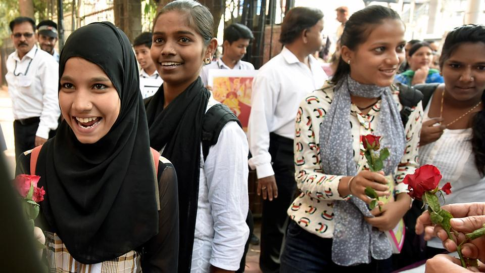 Students are welcomed with flowers on the first day of Secondary School Certificate exams at Saraswati Mandir High School in Mahim area of Mumbai on Tuesday. (Kunal Patil/HT)