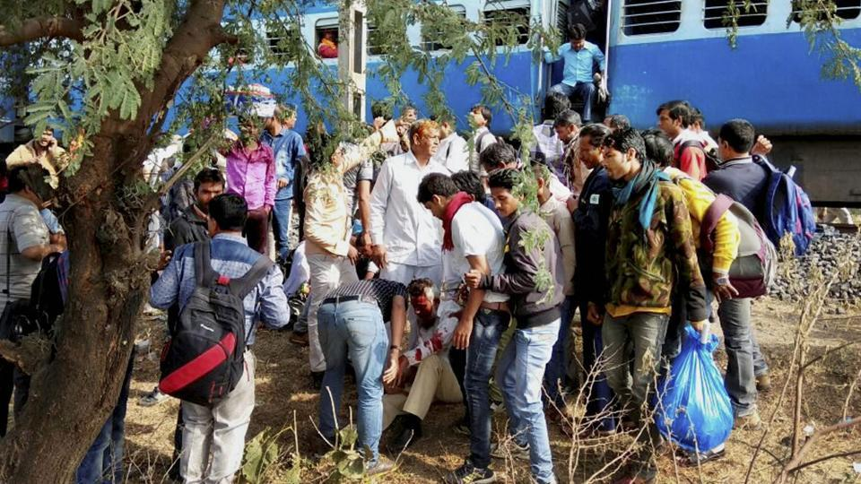 People attend to an injured person after a blast in the Bhopal-Ujjain passenger train near Jabdi station in Shajapur district of Madhya Pradesh.