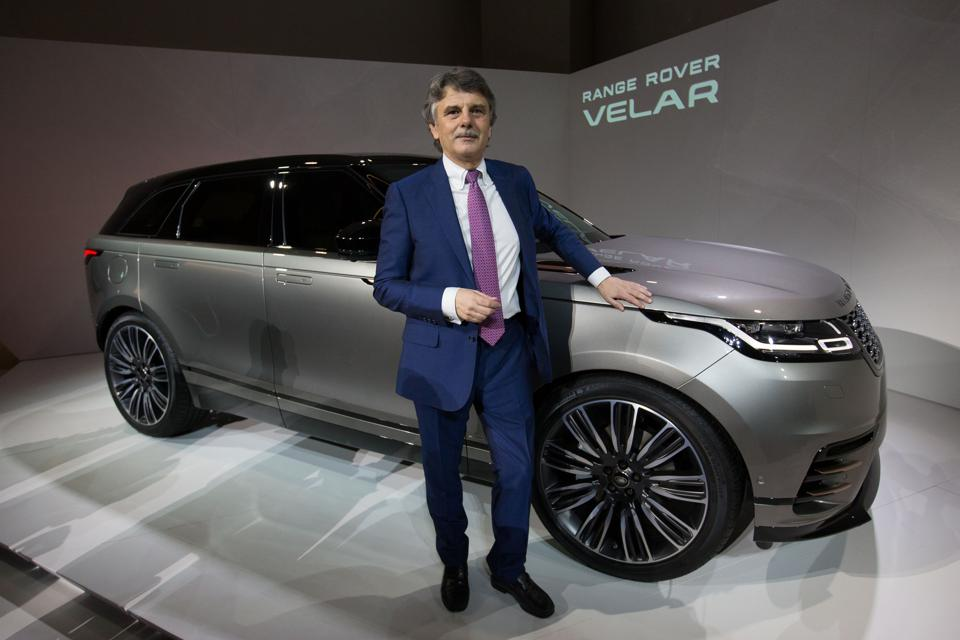 Jaguar Land Rover CEO Ralph Speth poses alongisde the new Range Rover Velar during its unveiling at the London Design Museum in London on March 1, 2017. / AFP PHOTO / Daniel LEAL-OLIVAS