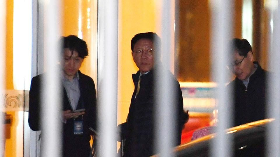 North Korean ambassador to Malaysia Kang Chol (C) waits to get into a car after arriving at the Beijing Airport, following his expulsion from Malaysia in a deepening diplomatic dispute over the assassination of the half brother of Pyongyang's leader.