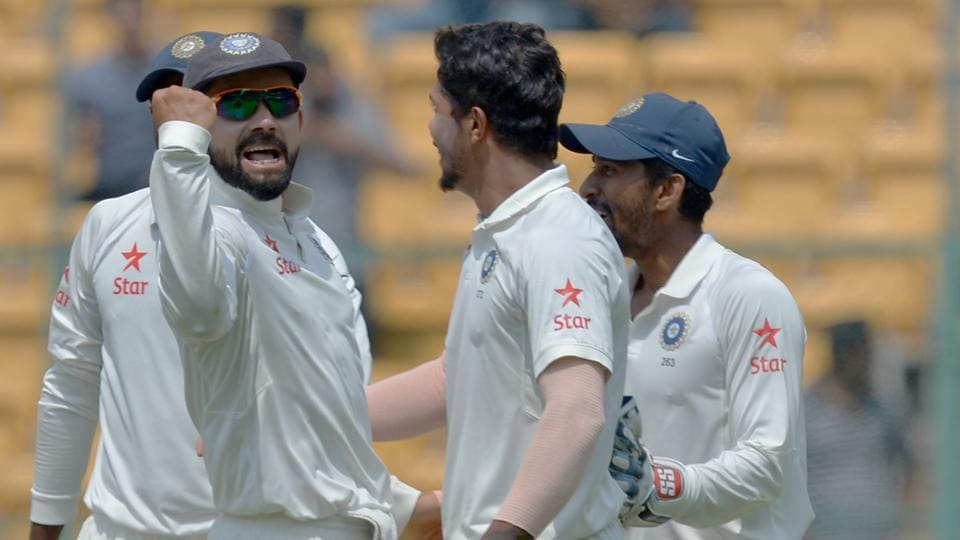Umesh Yadav (2R) celebrates the dismissal of Steve Smith during the second Test match between India and Australia.