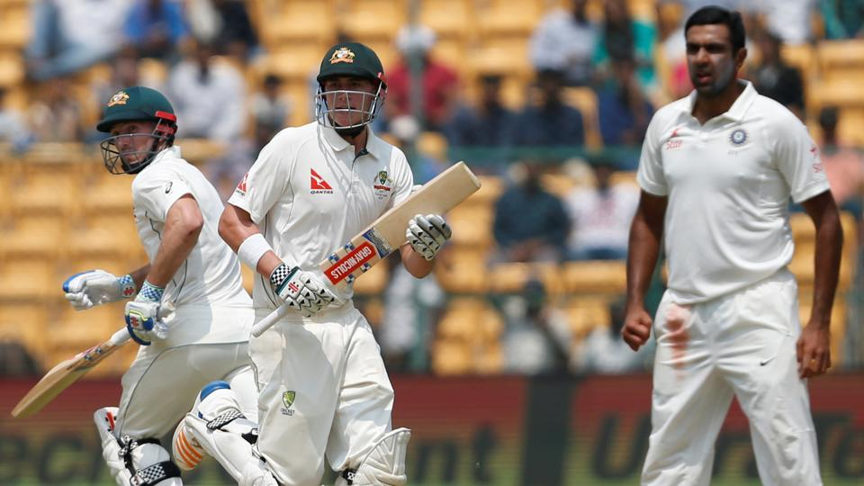 Australia's Matt Renshaw and Shaun Marsh run between the wickets as India's Ravichandran Ashwin (R) looks on. (REUTERS)