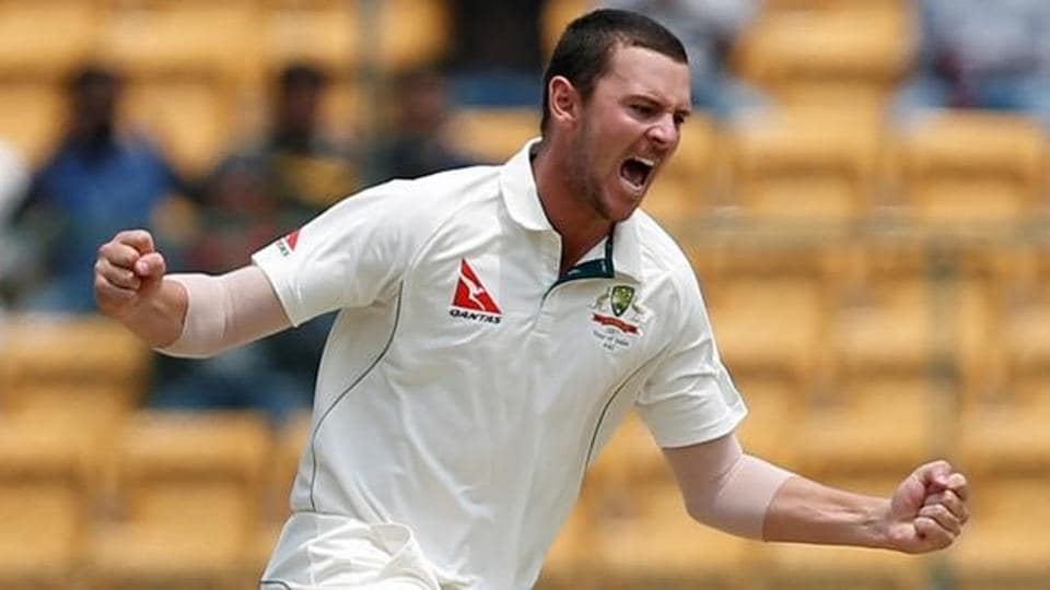 Josh Hazlewood celebrates after taking a wicket against India on Day 4 of the Bangalore Test.