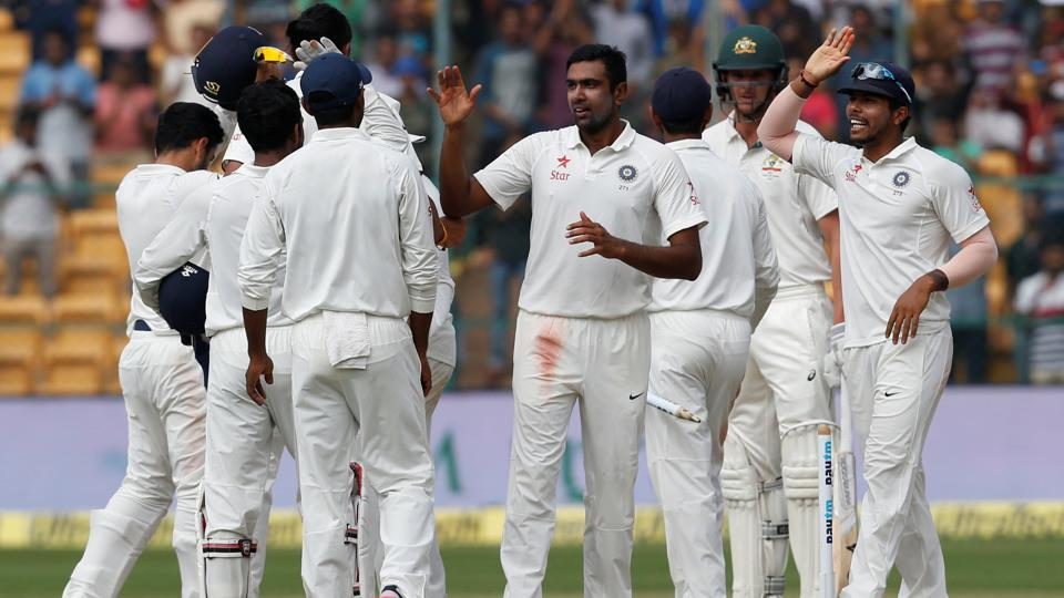 Indian cricket team players celebrate after winning the second Test match against Australia in Bangalore.