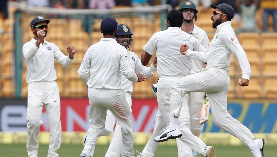 India captain Virat Kohli (right) celebrates the wicket of Australia's Mitchell Marsh in Bangalore on Tuesday.