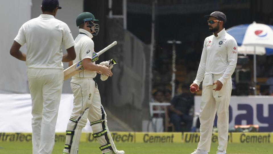 Virat Kohli chat with Steve Smith during day four of the second Test between India and Australia at the M Chinnaswamy Stadium in Bangalore on Tuesday.