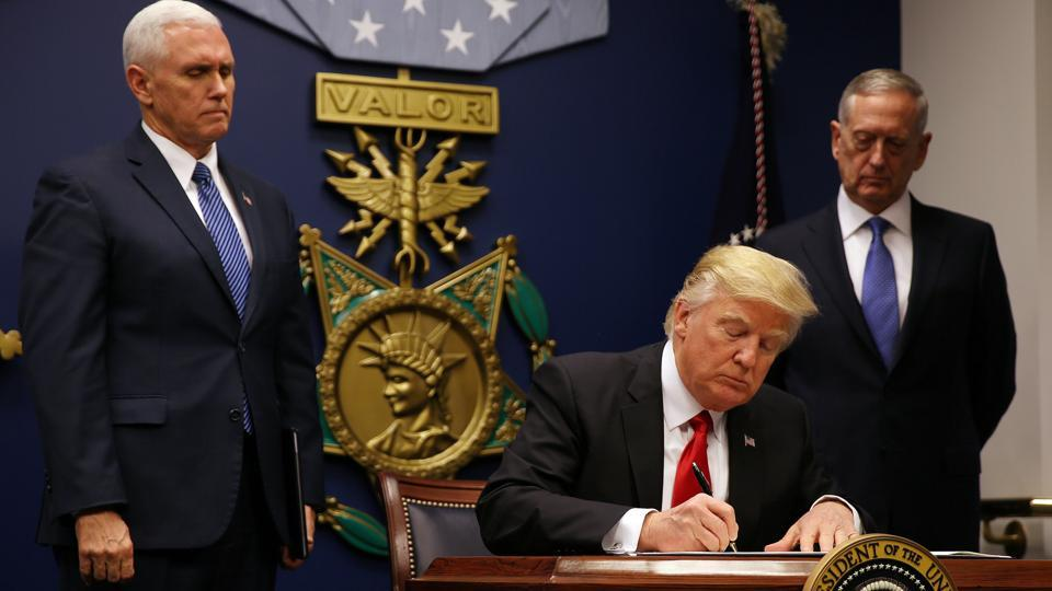 US President Donald Trump signed an executive order for a US travel ban, at the Pentagon in Washington on January 27, 2017.  Trump administration issued a new order on March 6 temporarily baring citizens of six Muslim-majority nations from entering the country.