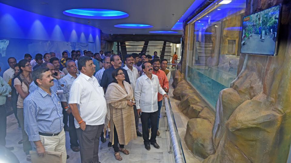 Standing committee members inspect the new penguin enclosure at Byculla zoo in Mumbai.