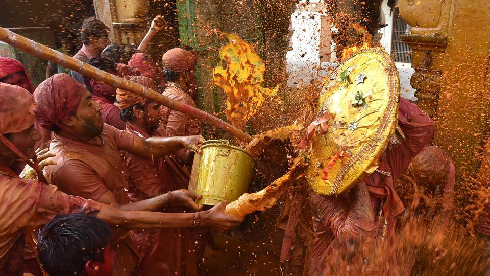 Lathmar Holi is celebrated days before the actual Holi. (Ajay Aggarwal/HT PHOTO)