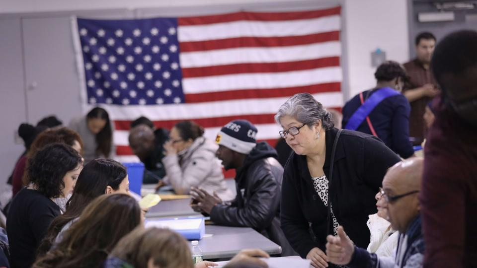 Immigrants receive assistance to complete their US citizenship applications during a Citizenship Now! event held in the Bronx in New York City. The United States is considering separating immigrant children from their parents in a bid to deter illegal migration.